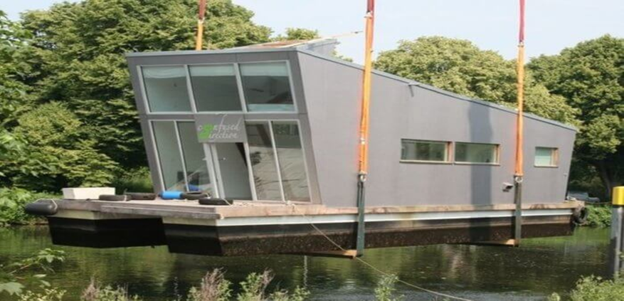 Green roofed Schwimm Haus Boat by German architects.